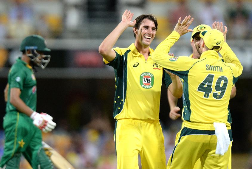 Pat Cummins celebrates taking a wicket against Pakistan in Brisbane