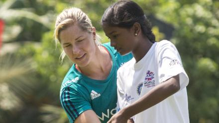 Katherine Brunt shows how to play with a straight bat at the England Womens Cricket for Good clinic