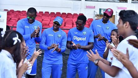 Darren Sammy leads the how to wash hands example at West Indies Cricket for Good clinic