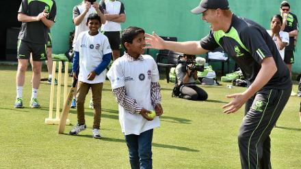 Kevin OBrien inspires a youngster at a Cricket for Good clinic at WT20
