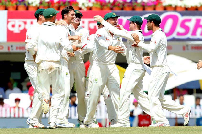 Pat Cummins and Australia celebrate the wicket of Virat Kohli