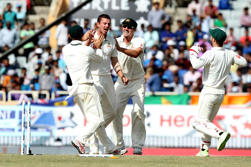 Josh Hazlewood and Australia celebrate the wicket of Karun Nair