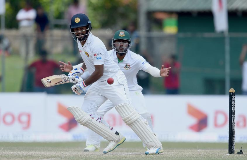 Dimuth Karunaratne played a composed knock and bought up his 126 from 244 balls studded with ten boundaries and a six