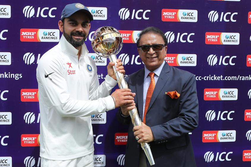Virat Kohli poses with the mace along with Sunil Gavaskar