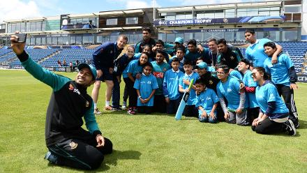 Bangladeshi cricketers with local school children during an ICC Champions Trophy Cricket for Good clinic at Cardiff, Wales.