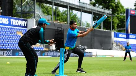 Mushfiqur Rahim looks on as a young kid plays a shot during the ICC Champions Trophy Cricket for Good clinic at Cardiff, Wales.