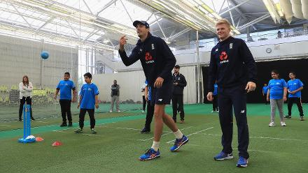 Steve Finn and Sam Billings of England enjoy a game of cricket with local school children during the ICC Champions Trophy Cricket for Good clinic at Birmingham.