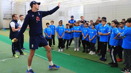 Steven Finn of England shows young school children the nuances of bowling during an ICC Champions Trophy Cricket for Good clinic at Birmingham.