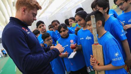 Jonny Bairstow of England signs an autograph for young school children during an ICC Champions Trophy Cricket for Good clinic at Birmingham.