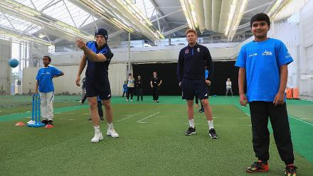 David Willey and Jonny Bairstow of England with local school children during an ICC Champions Trophy Cricket for Good clinic at Birmingham.