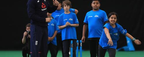 Sam Billings of England enjoys a game of cricket with young school kids during an ICC Champions Trophy Cricket for Good clinic at Birmingham.