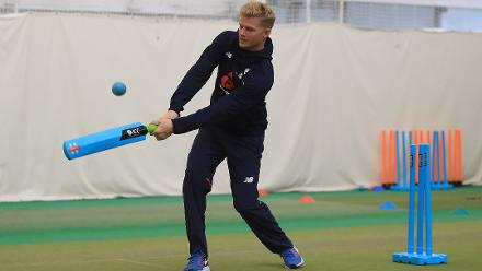Sam Billings of England enjoys a game of cricket with young school children during an ICC Champions Trophy Cricket for Good clinic at Birmingham.