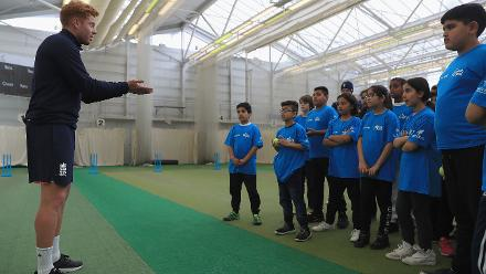 Jonny Bairstow of England teaches young school children the skills of wicket-keeping during an ICC Champions Trophy Cricket for Good clinic at Birmingham.