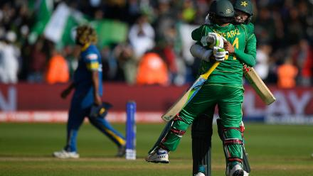 Mohammad Amir and Sarfraz Ahmed celebrate after putting on an unbeaten 75-run stand for the eighth wicket to take Pakistan home with three wickets to spare.