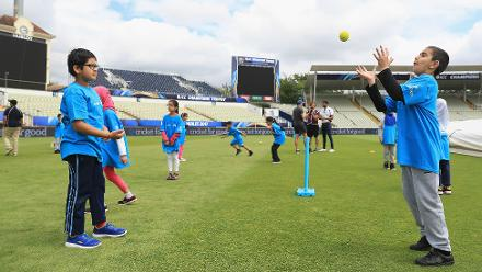 Local children practice fielding skills at the Cricket For Good coaching clinic at Birmingham.