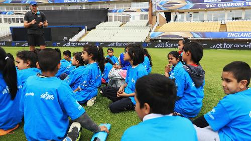 Mike Hussey interacts with children at the Cricket For Good coaching session in Birmingham.