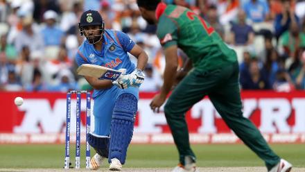 Rohit Sharma plays a shot off the bowling of Mashrafe Mortaza