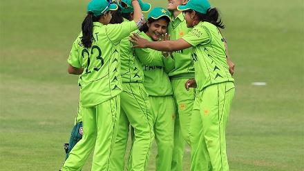 Javeria Wadwood is congratulated by her teammates for the wicket of Trisha Chetty