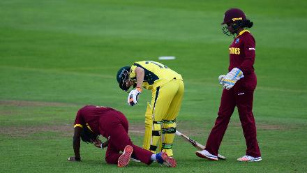 Shakera Selman of West Indies lies on the floor after being hit by a shot from Nicole Bolton