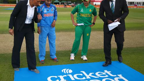 Mithali Raj of India and Sana Mir of Pakistan take part in the coin toss during the ICC Womens World Cup match between India and Pakistan