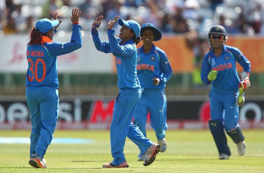 Ekta Bisht of India celebrates with Mona Meshram of India after bowling out Diana Baig of Pakistan.