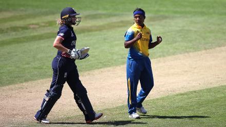 Ama Kanchana of Sri Lanka celebrates the wicket of Lauren Winfield of England.