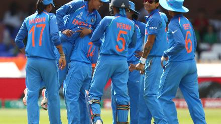 Ekta Bisht of India is lifted off the ground by team-mates after taking the wicket of Sidra Nawaz of Pakistan.