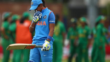 Harmanpreet Kaur of India reacts after being caught out by Sana Mir of Pakistan.