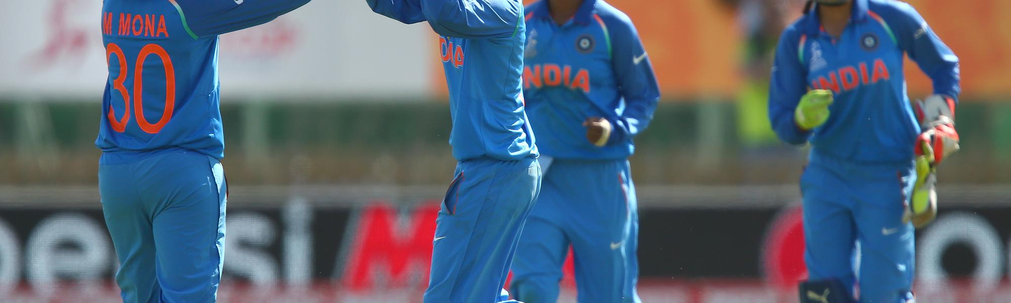 Ekta Bisht of India celebrates with Mona Meshram of India after bowling out Diana Baig of Pakistan.