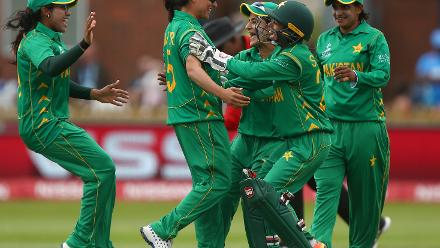 Sana Mir celebrates with team mates after taking a catch to claim the wicket of Harmanpreet Kaur of India.