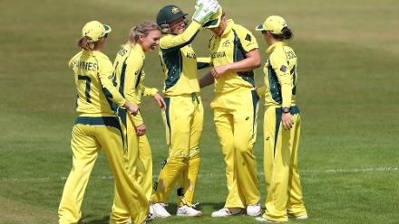 Austalian players celebrate the wicket of Marina Iqbal.