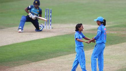 Poonam Yadav celebrates the wicket of Athapaththu with Harmanpreet Kaur