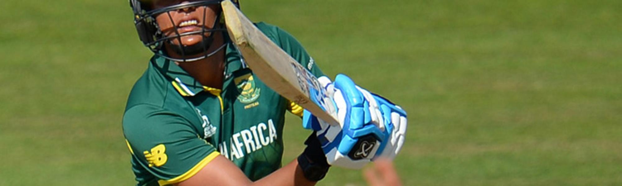 Chloe Tryon of South Africa bats as Danielle Hazell of England attempts to stop the ball during the ICC Women's World Cup 2017 match.
