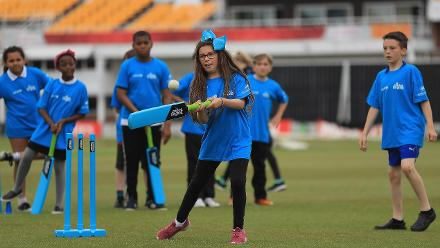 Local school children in action during an ICC Cricket for Good clinic at Grace Road