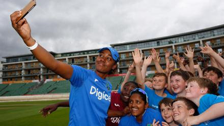 Hayley Matthews takes a selfie with local school children during an ICC Cricket for Good clinic at The County Ground