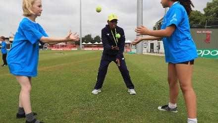 Raisibe Ntozakhe of South Africa coaches local school children during an ICC Cricket fo Good clinic at Grace Road