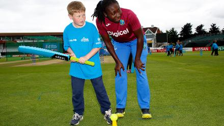 Stafanie Taylor with local school children during an ICC Cricket for Good clinic