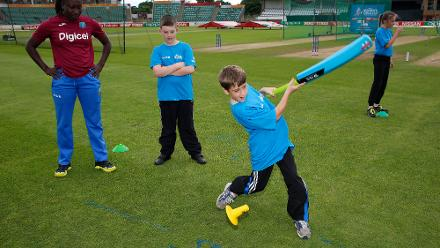 Stafanie Taylor, the captain of West Indies  with local school children during an ICC Cricket for Good clinic at The County Ground