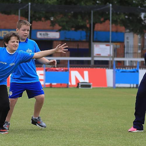 Dane van Niekerk of South Africa coaches local school children during an ICC Cricket for Good clinic at Grace Road