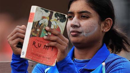 Mithali Raj enjoys a book before going out to bat