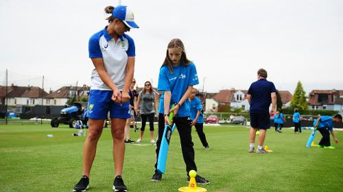 Ashleigh Gardner of Australia gives advice during the ICC Cricket for Good - Australia event at the Brightside Ground  in Bristol