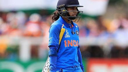 A disappointed Mithali Raj walks off after being dismissed for a duck by Dane van Niekerk