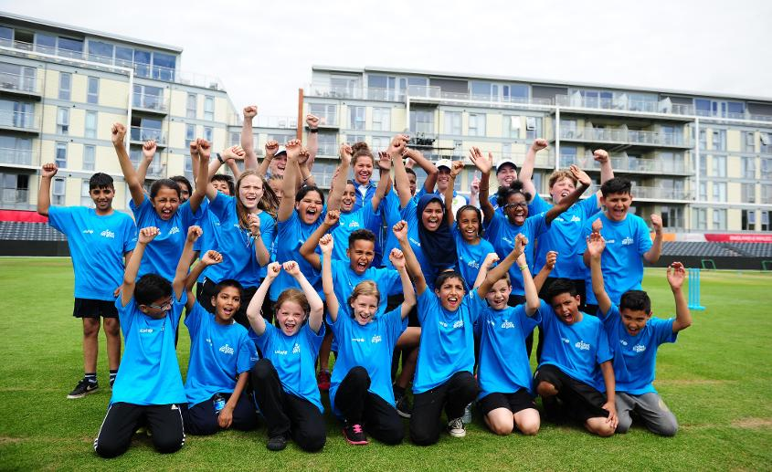 Schoolchildren pose alongside members of the Australian side for a group photo during the ICC Cricket for Good - Australia event at the Brightside Ground