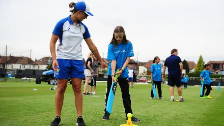Ashleigh Gardner of Australia(L) gives advice during the ICC Cricket for Good - Australia event at the Brightside Ground