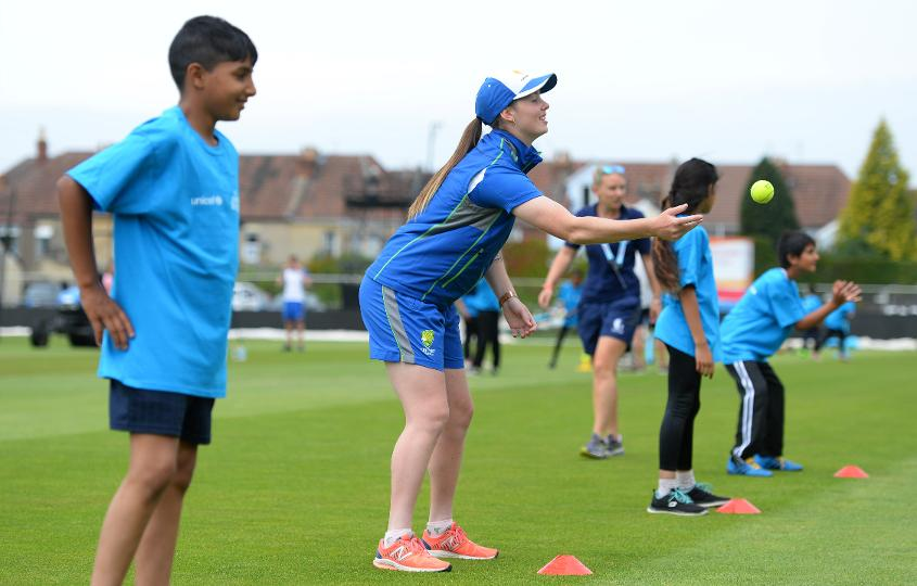 Amanda Wellington of Australia(C) throws a ball alongside Schoolchildren during the ICC Cricket for Good - Australia event at the Brightside Ground