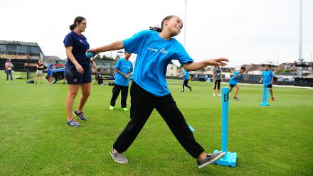 Schoolchildren take part in a bowling exercise during the ICC Cricket for Good - Australia event at the Brightside Ground