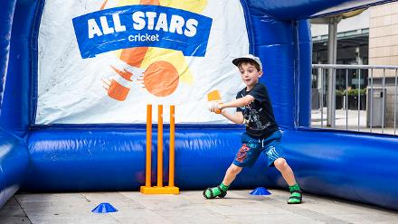 A kid plays a shot at the First ICC Women's World Cup Fan Park.
