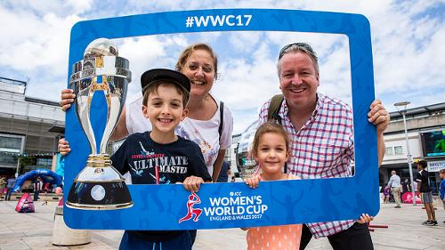 A family strikes a pose at the ICC Women's World Cup Fan Park.