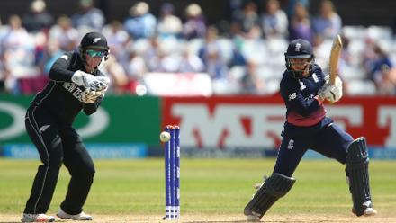 Tammy Beaumont of England plays a shot in front of Rachel Priest.