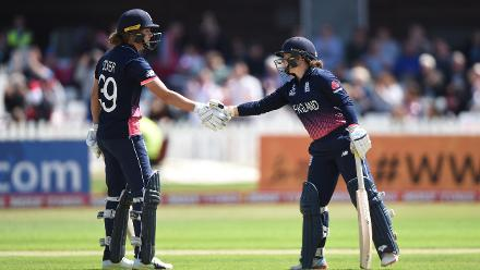 Natalie Sciver shakes Tammy Beaumont's hand after she scores her half-century.